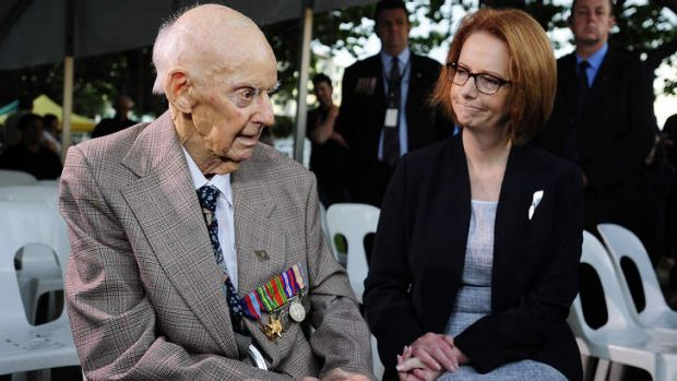 Prime Minister Julia Gillard talks with former P.O.W Sidney King at the dawn service in Townsville.