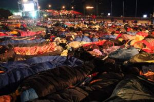 Thousands sleep outside before a ceremony marking the 98th anniversary of Anzac Day at Anzac Cove, in western Canakkale.