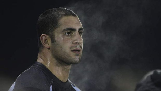 Sharks prop Johnny Mannah watches on from the bench during the round 15 NRL match between the Cronulla Sharks and the ...