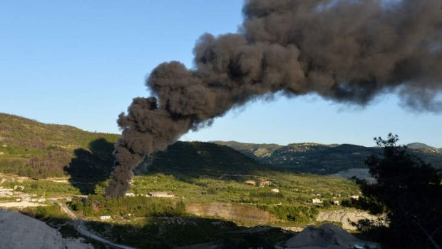 Alarm: Smoke rises after shelling on al-Turkman mountains in western Syria on Thursday.