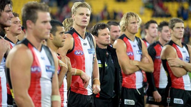 Successful venture: but not by the looks on these faces. Coach Scott Watters and Saints players show their ...