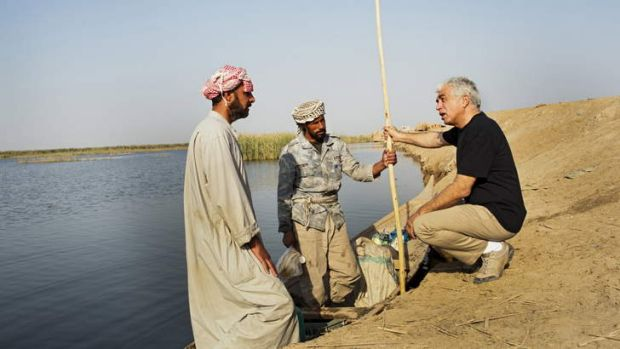Flow on effect: Azzam Alwash speaks with a fish seller in Kirmashiye's central marshes in 2012. After 10 years of ...