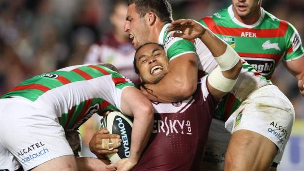Sam Burgess gets to grips with Steve Matai.