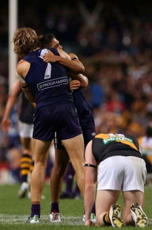 Onya mate: Fremantle's Michael Walters and Nat Fyfe celebrate the one-point win over Richmond.