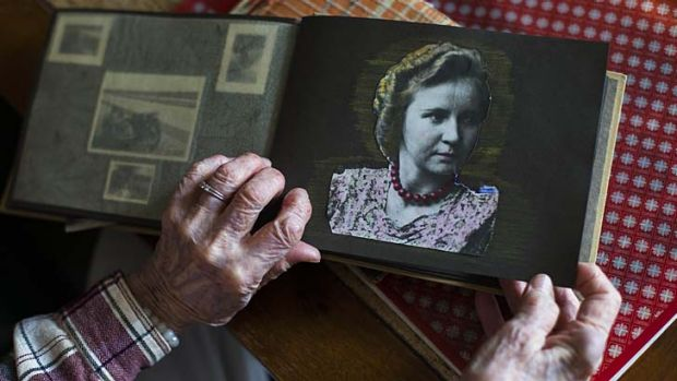 Memories ... Woelk shows an old photo album with a picture of herself taken around 1939 or 1940.