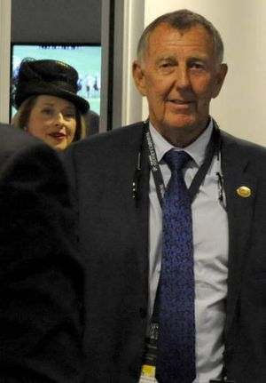 Racehorse owner John Singleton and trainer Gai Waterhouse leave the stewards' room at Royal Randwick in Sydney on Saturday.