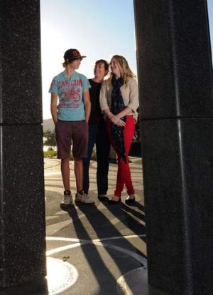 Fiona Vickery and her children, Jay, left and Skye, visit the memorial site.