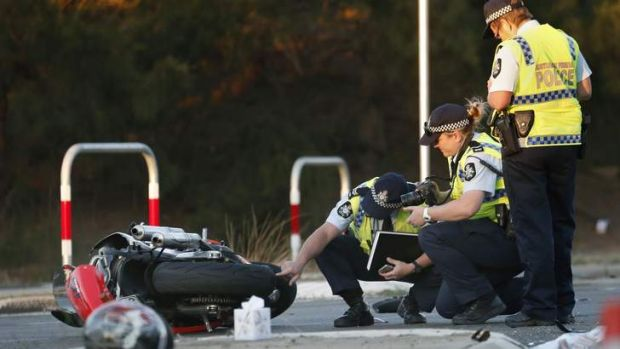ACT Policing at the scene following a crash that left a motorcyclist in a critical condition at the intersection of ...