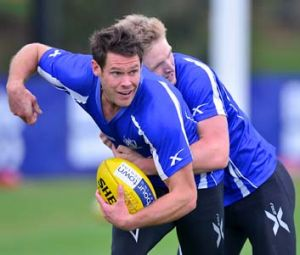 Hard worker: Sam Gibson is tackled by Jack Ziebell at North Melbourne training.