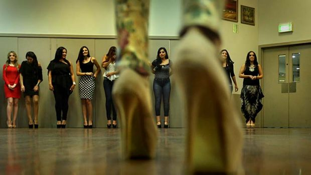 In the race: Contestants rehearse for the beauty pageant.