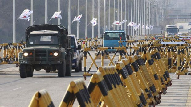 A South Korean military vehicle crosses Unification Bridge, which leads to the demilitarised zone separating North Korea ...