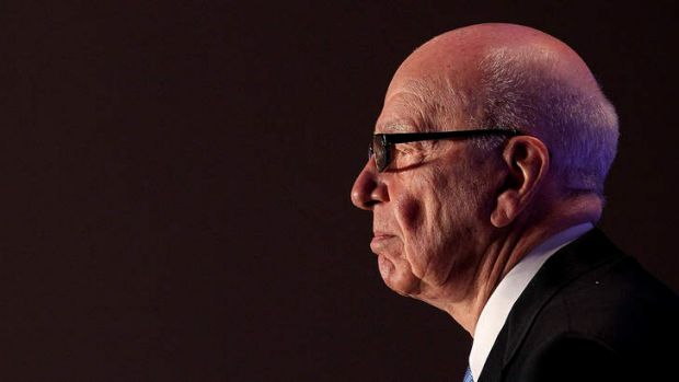 What a performer: Double duties for Rupert Murdoch.