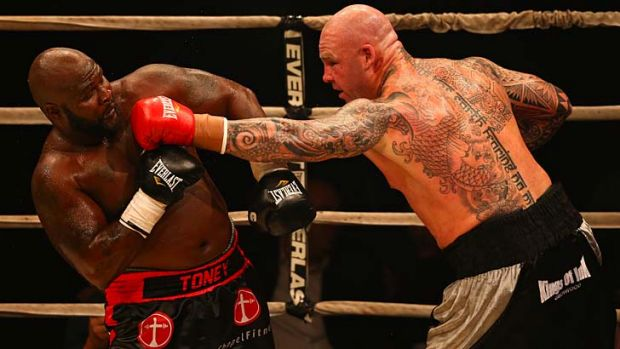 Lucas Browne throws a punch at James Toney during the WBC Super Heavyweight bout on Sunday.
