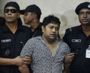Caught: Sohel Rana is escourted by police.