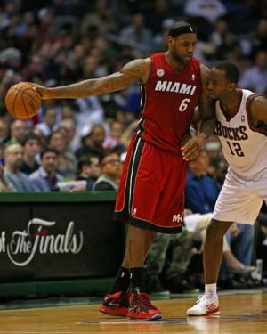 LeBron James readies to move against Luc Richard Mbah a Moute of the Milwaukee Bucks.
