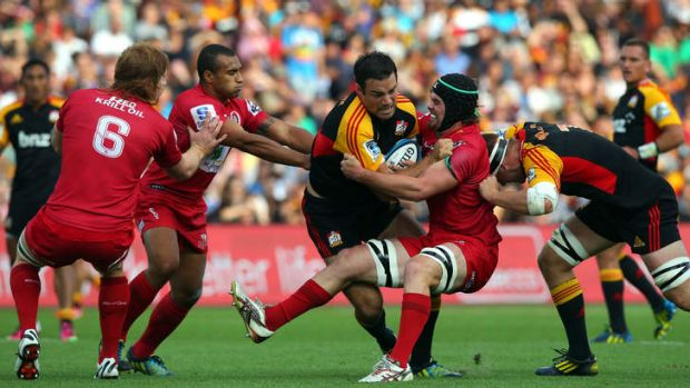 High praise ... the Reds neutralise Richard Kahui of the defending champion Chiefs.  Australia's Super Rugby sides have ...