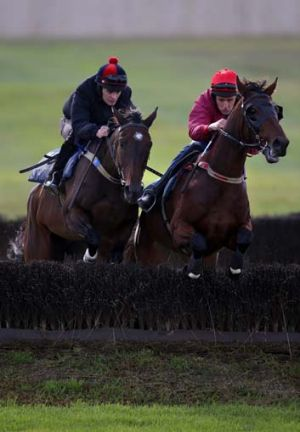 Irish jockeys Tom Ryan, riding Man of Class, and Shane Jackson, riding Dhaafer, get in some practice over the ...