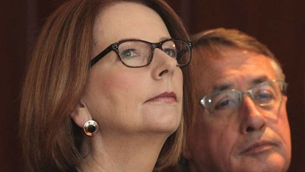 Bold declaration: Julia Gillard and Treasurer Wayne Swan before her speech in Canberra on Monday.