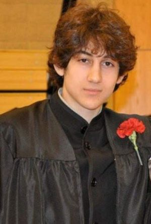 Dzhokhar Tsarnaev poses for a prom photo after graduating from high school.
