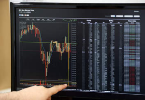 A  monitor displays the MtGox bitcoin exchange website on April 25, 2013.