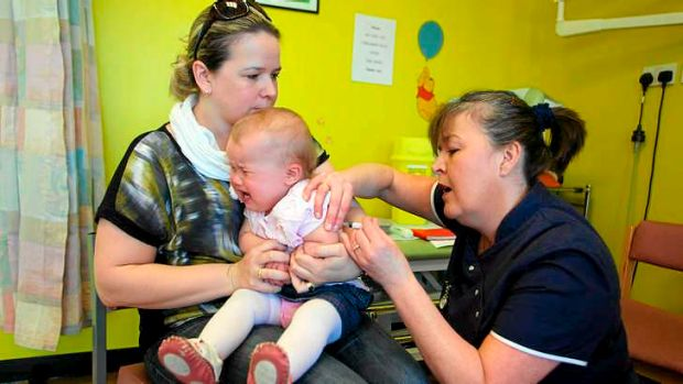 Amelia Down, 14 months, receives the combined measles, mumps and rubella vaccination in Swansea.
