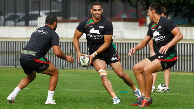 Target: Greg Inglis came in for extra attention from Manly. Right, Sam Burgess.