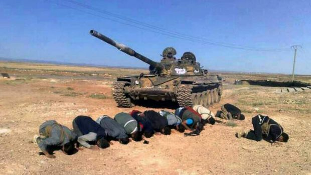 Syrian rebels praying in front their tank, at al Mutayia village, in the southern province of Daraa. The Obama ...