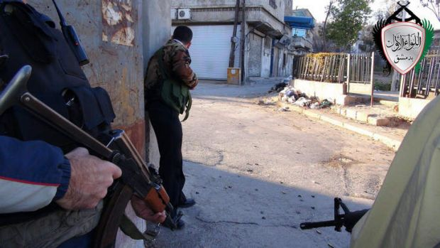 Syrian rebels taking cover in  Damascus.