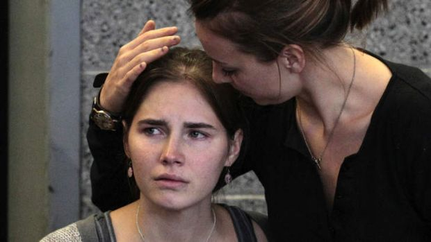 Amanda Knox is comforted by her sister, Deanna, after arriving home in Seattle following her release from prison in ...