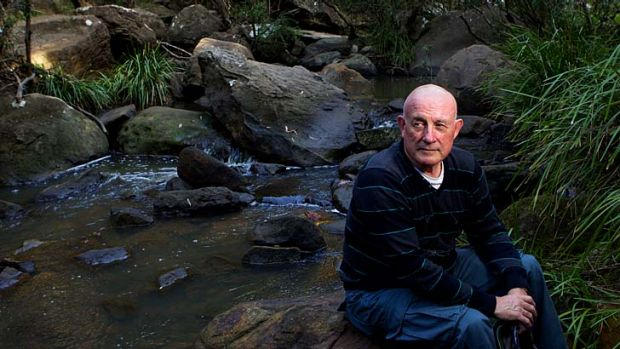 Let down: Ken Hall, at the Georges River near his home, believes BHP should act quicker.