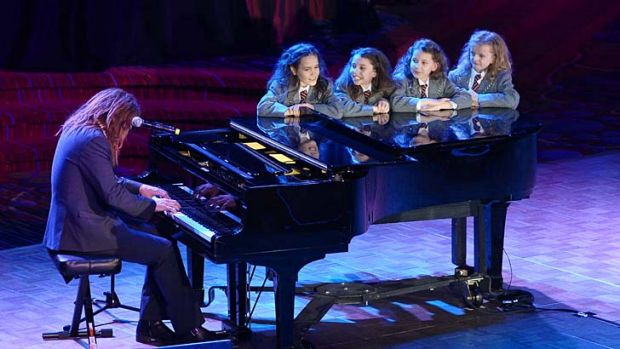 Tim Minchin performs onstage with the cast of <i>Matilda</i>.