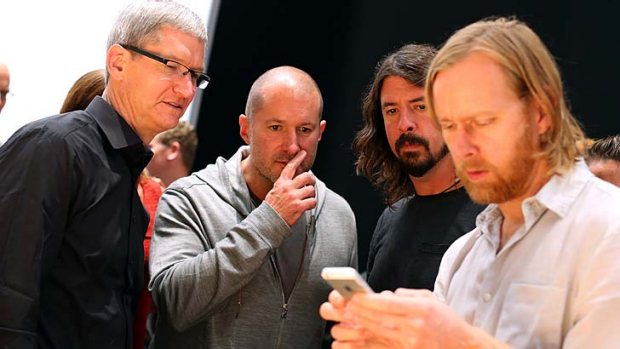 Apple CEO Tim Cook, left, Apple senior vice president of Industrial Design, Jonathan Ive, centre, and Dave Grohl of the ...