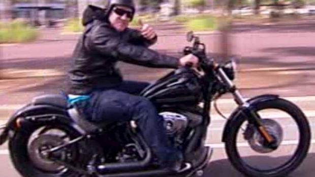 Hell for leather: Paul Gallen rides his Harley-Davidson out of ANZ Stadium yesterday.