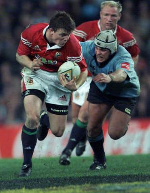Young Lion: O'Driscoll outstrips an equally youthful Phil Waugh during his first Lions tour, in 2001.