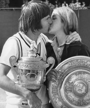 Jimmy Connors kisses his fiancee Chris Evert after winning the men's singles final at Wimbledon on July 6, 1974. Evert ...
