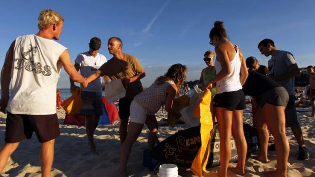 Helping hands: Justin Bonsey, founder of Responsibly Runners, welcomes a volunteer to the group's beach clean-up.