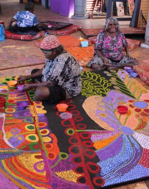 Traditional artists Wawiriya Burton (left) and Ruby Williamson. Artworks from South Australia's Tjala Arts range from ...