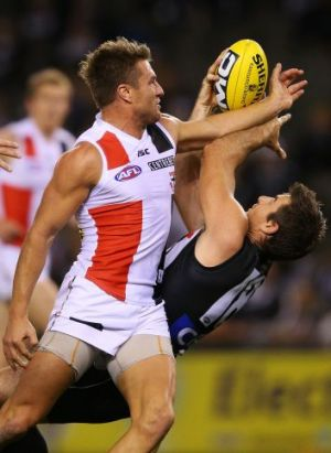 Darren Jolly marks against St Kilda defender Sam Fisher
