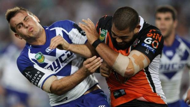 Shoulder to shoulder: Dogs five-eighth Josh Reynolds cops a big hit from Adam Blair.