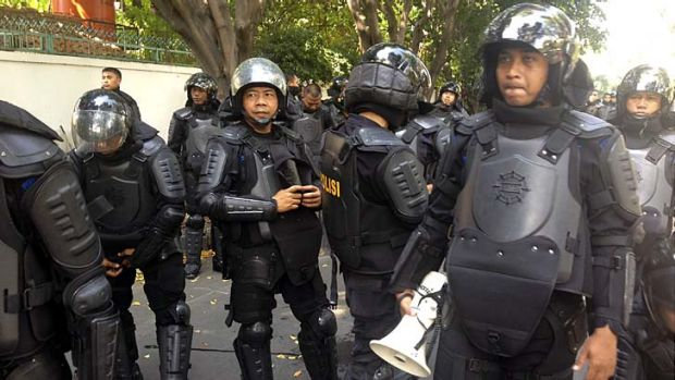 Street protest: Riot police protect the Myanmar embassy in Jakarta.