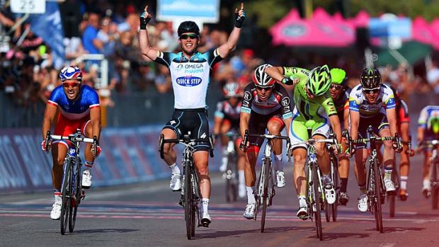 Did his homework: Great Britain's Mark Cavendish from team Omega Pharma - Quick-Step celebrates as he crosses the finish ...