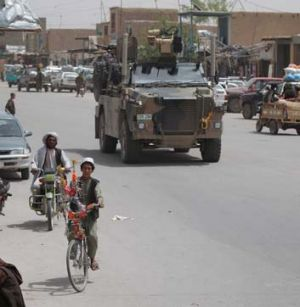 A Bushmaster drives through Tarin Kowt town during an operation to inspect a new road in Oruzgan province.