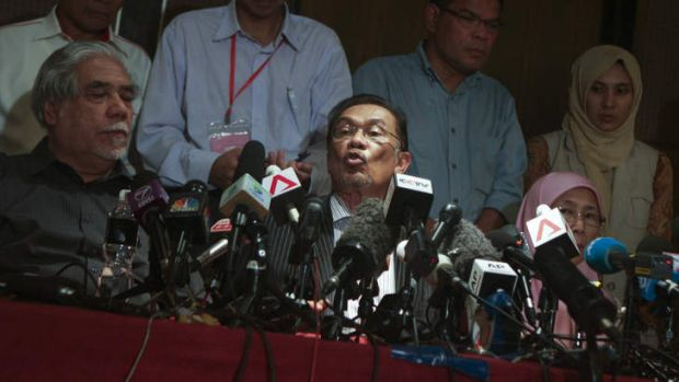 Leader of Pakatan Rakyat, Anwar Ibrahim presents accusations of electoral fraud during a press conference in One World ...