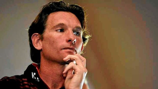 Spotlight: Essendon coach James Hird looks on as chairman Dave Evans discusses the findings of Dr Ziggy Switkowski's ...