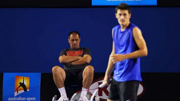Working on the backhand: John (left) and Bernard Tomic in January last year.