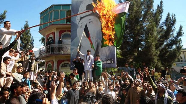 Cross-border clashes flare-up: Afghan protesters burn a Pakistani flag after Kabul and Islamabad engage in a war of ...
