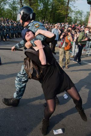 A Russian police officer detains protester Alexandra Dukhanina during an opposition rally in Moscow in 2012.