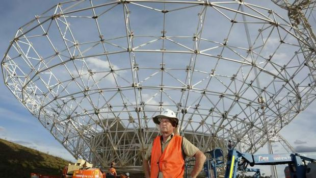 Civil technician David True in front of DSS-35 a new 34 m beam waveguide antenna being constructed at the Canberra Deep ...