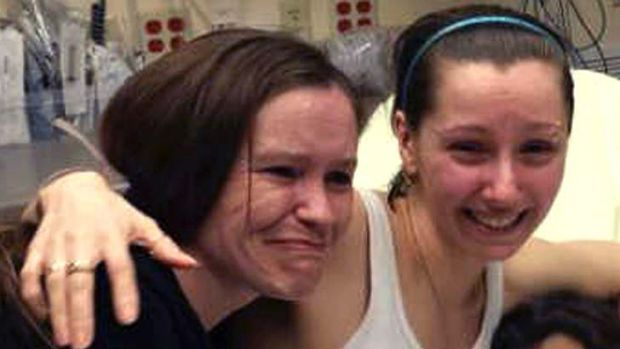 "Together again: Amanda Berry, right, with her sister Beth Serrano after being reunited. A source said:  ""There is a ..."