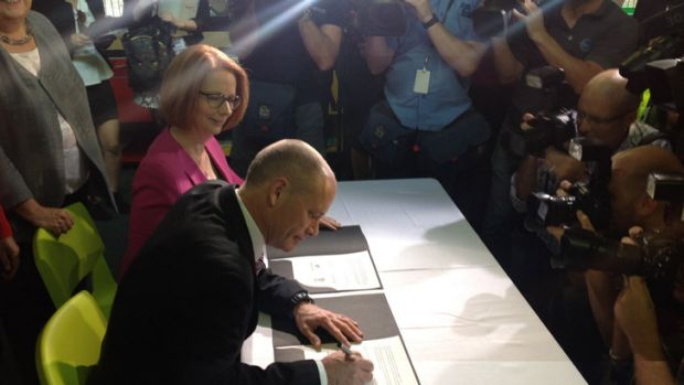 Signed... Premier Campbell Newman and PM Julia Gillard agree on the NDIS.